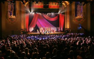 Multicultural performing arts group on stage at Balboa Theatre