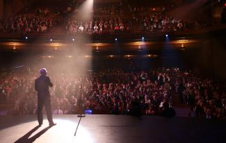 Photograph of comedian on stage at Balboa Theatre