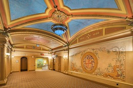 Photo of the Balboa Theatre lobby with vaulted blue ceiling