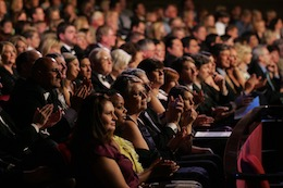 Photo of an audience at the San Diego Civic Theatre watching a performance.